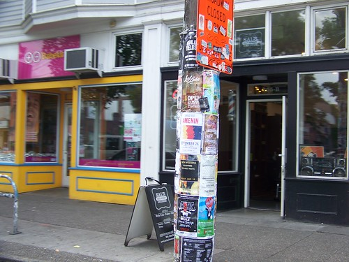 Telephone/utility pole in Seattle, plastered with posters