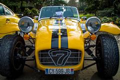 race car, automobile, lotus seven, yellow, wheel, vehicle, automotive design, caterham 7, antique car, vintage car, land vehicle, sports car, motor vehicle,