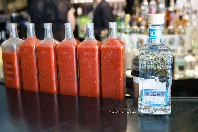 Olmeca Altos Blanco Tequila with the bottles of Bloody Maria mixes