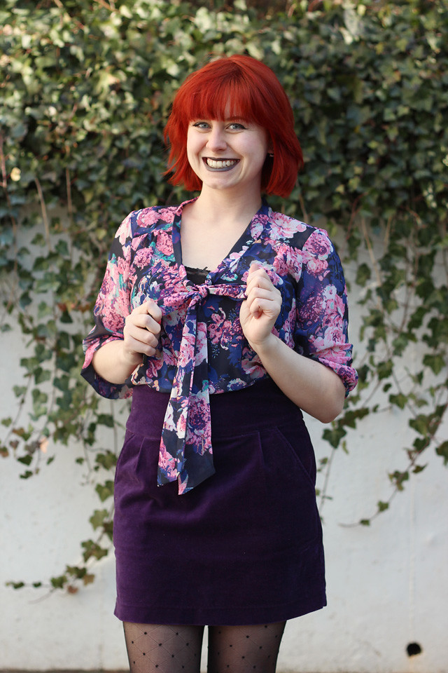 Pink, Purple, and Black Floral Pussy Bow Blouse with Red Hair and a Purple Skirt