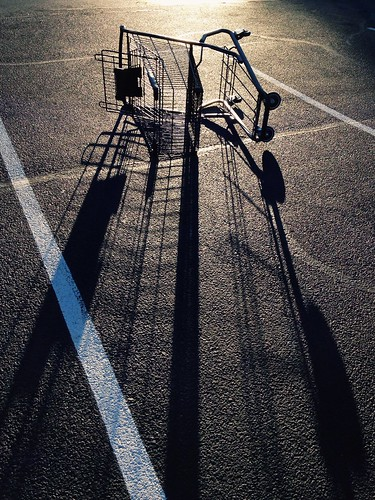 sunset shadow silhouette parkinglot shoppingcart