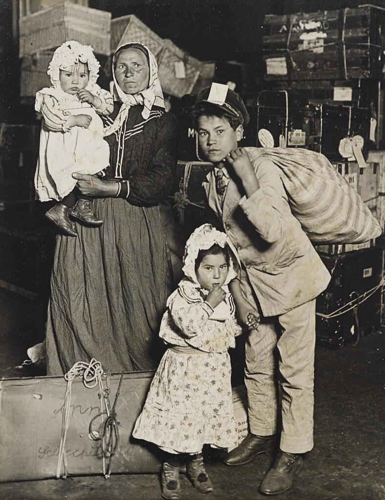 Lewis Wickes Hine - Italian Family Looking for Lost Baggage, Ellis Island [1905]