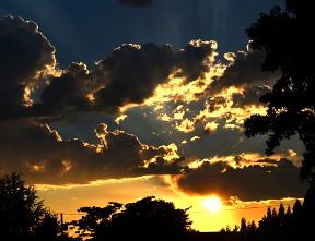 blue sunset sky clouds sunrays
