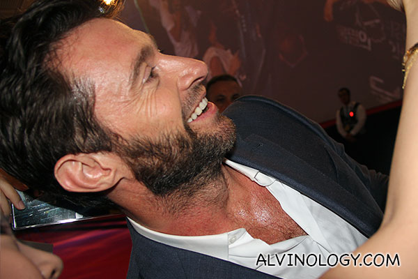 Some of the lucky fans get to take really close shots with Hugh Jackman like this lady here