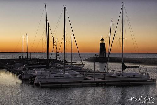 sunset lighthouse oklahoma water night sailboat landscape boating oklahomacity lakehefner yabbadabbadoo canon24105mmf4lisusm topazclarity