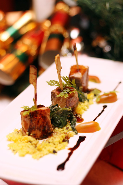 Skewered Salmon Medallion with Apricot-Olive Couscous and Sautéed Baby Greens