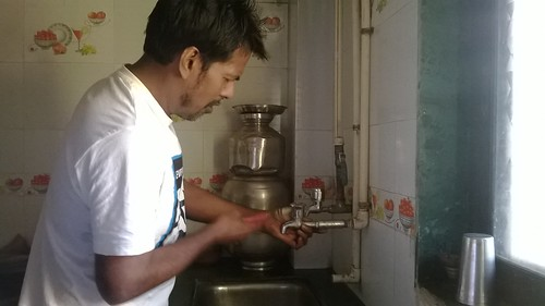 Plumber Riyaz Ahmad checks the reason for the leak.