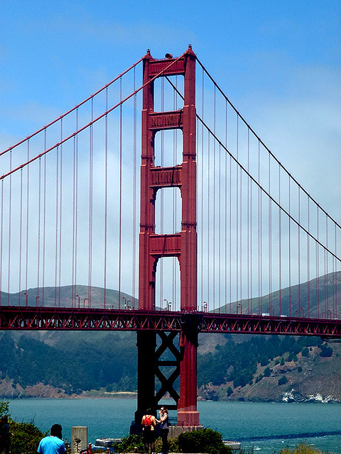 View of one of the golden gate bridges iconic towers from the embankment on the San Francisco side showings its incredible shape and form