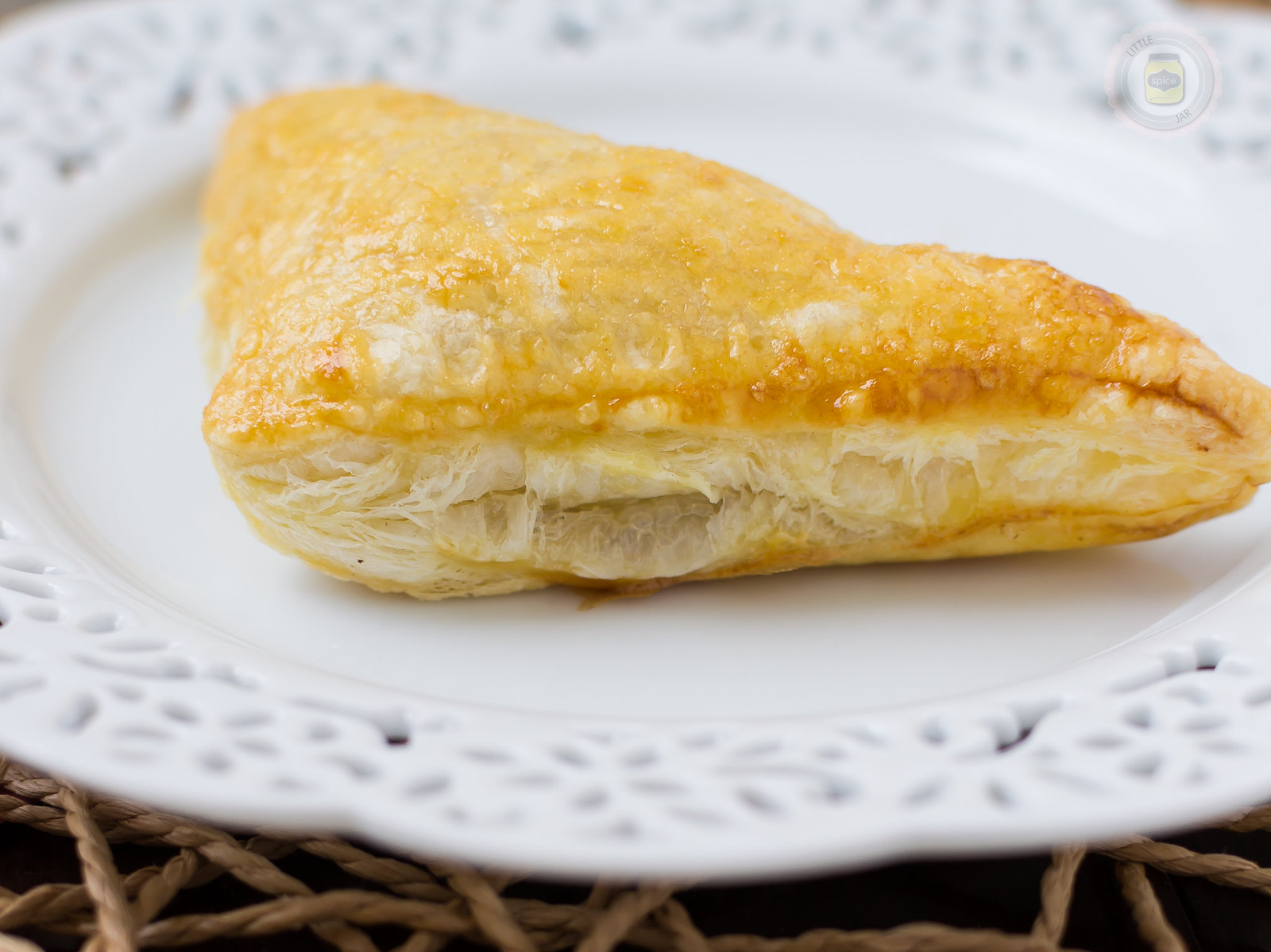 Chicken Puff Pastry Triangle close up shows puff pastry texture