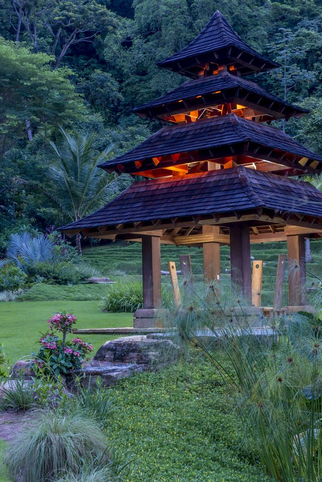 Illuminated Pagoda surrounded by lawn and extensive plantings