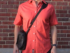 leather(0.0), jacket(0.0), pattern(1.0), clothing(1.0), collar(1.0), dress shirt(1.0), red(1.0), sleeve(1.0), maroon(1.0), outerwear(1.0), shirt(1.0),