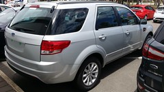 ford escape(0.0), ford taurus x(0.0), ford escape hybrid(0.0), automobile(1.0), automotive exterior(1.0), sport utility vehicle(1.0), mini sport utility vehicle(1.0), vehicle(1.0), compact sport utility vehicle(1.0), crossover suv(1.0), bumper(1.0), ford(1.0), land vehicle(1.0),