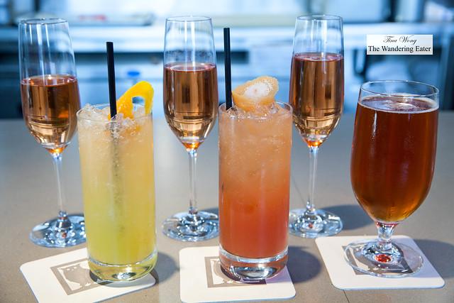 Our beverages -  Glasses of Champagne Paul Bara, Bouzy, Brut Rosé Grand Cru, yuzu soda, blood orange soda, Evolution Seasonal Beer