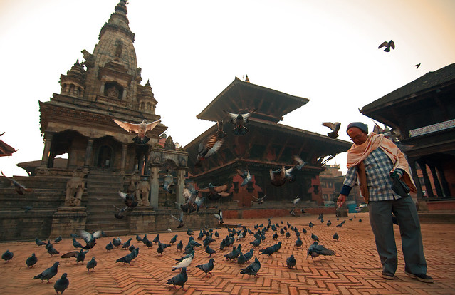 558-Old man feeding birds pigeons in Bhaktapur Durbar square Dec 15, 2011 7-12 AM 4208x2723