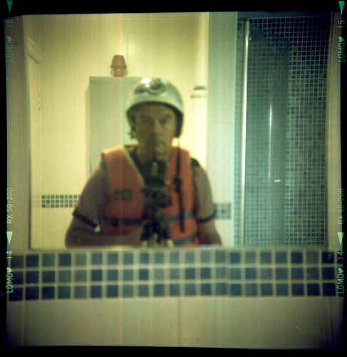 reflected self-portrait with Dacora Daci camera and safety helmet by pho-Tony