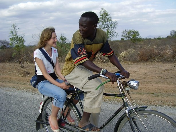 A tourist enjoying local bicycle ride in Buigiri village during village cultural experience in Buigiri village, Dodoma