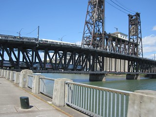 Two trains cross the Steel Bridge