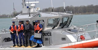 Members of Coast Guard Station Belle Isle in Detroit, and a member of the Royal Canadian Mounted Police pose for a photo on a 45-foot patrol boat after conducting a joint patrol in Lake Erie, May 8, 2014.  The patrol is the first of many to come in the Great Lakes 2014 boating season and boaters can anticipate to see mixed crews on patrol in weeks to come.  U.S. Coast Guard photo courtesy of Coast Guard Sector Detroit