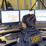 April 21, 2015 - 10:45 - The Sheriff's Office dispatches for 11 local agencies within the county.  All dispatchers for the Sheriff's Office are commissioned deputies, a rarity in dispatch centers.  This is a photo depicting the setup our dispatchers use to gather information and disseminate to the correct officers on the road so that we can get the public the help they need in a quick and thorough manner/
