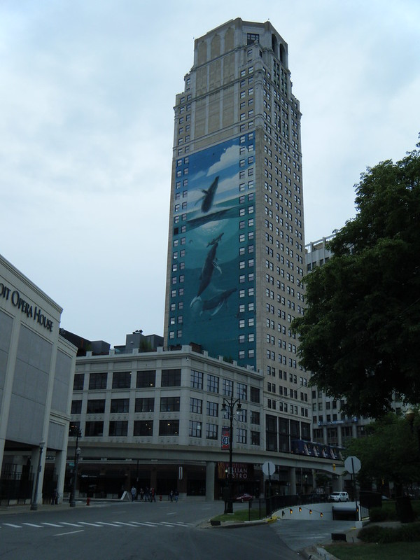 Broderick Tower with mural of whales