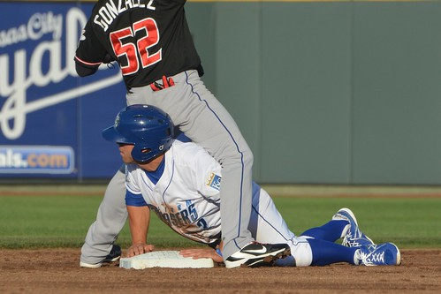 ...and then practically getting pinned to the base, so he couldn't move when the ball skipped past Gonzalez into the outifeld