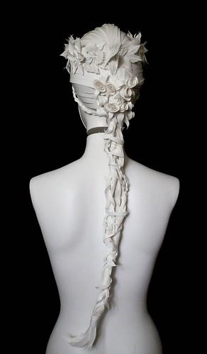 all-white ornate paper wig