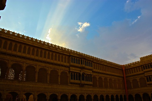 the late afternoon sun leaks over the top of the fort