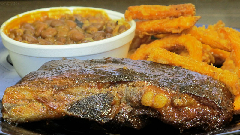 BBQ pork ribs, baked beans, and sweet potato fries
