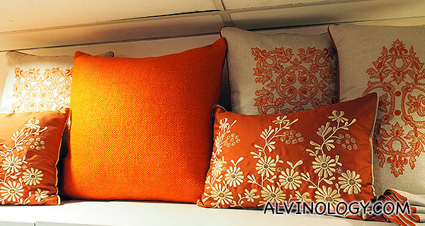 Orange floral themed cushion covers