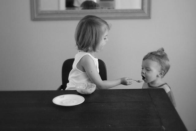 Eva feeds Theo