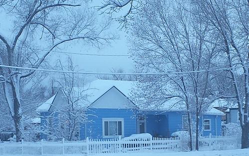 Snow On A Blue House