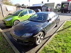 sports car(0.0), automobile(1.0), automotive exterior(1.0), wheel(1.0), vehicle(1.0), mazda(1.0), bumper(1.0), land vehicle(1.0), luxury vehicle(1.0), mazda rx-8(1.0),