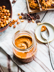 Fresh peanut butter in the pot and tea spoon, top…