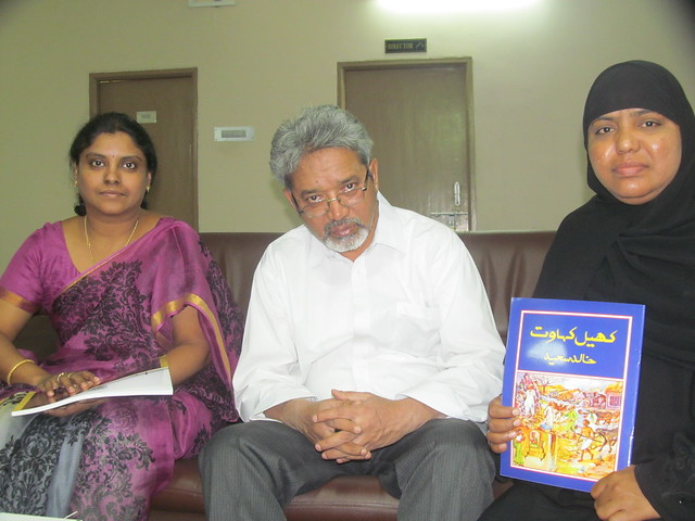 Professor Khalid Saeed (center)