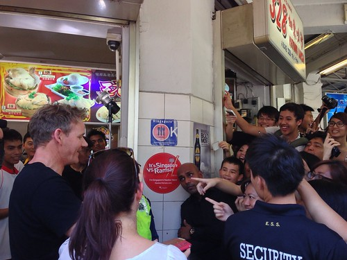 Gordon Ramsay taking a photo of the crowd at 328 Laksa. Someone had given him a camera to sign?