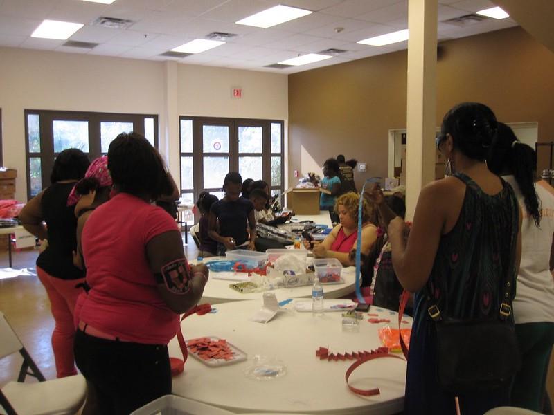 Inside the EC, volunteers prepared to distribute shirts, shoes, flip flops, backpacks, and school supplies.