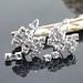 Small photo of Zilveren boog diamanten oorbellen
