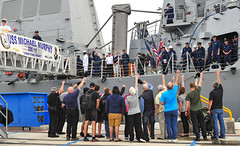 HMCS Protecteur family members express their appreciation for the assistance of the USS Michael Murphy (DDG 112) crew. (U.S. Navy/MC2  Tiarra Fulgham)