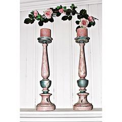 shelf(0.0), furniture(0.0), bottle(0.0), table(0.0), vase(0.0), iron(0.0), wine bottle(0.0), lighting(0.0), candle holder(1.0),