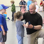 April 16, 2016 - 11:33 - Sgt. Tyson Kilbey high fives a young participant after she successfully demonstrates how to safely and correctly handle a firearm.  Sgt. Kilbey helped coordinate a Kids Handgun Safety & Awareness class for kids ages 5-12, where they learned the four cardinal rules to firearms safety and what to do if they ever come across a firearm.