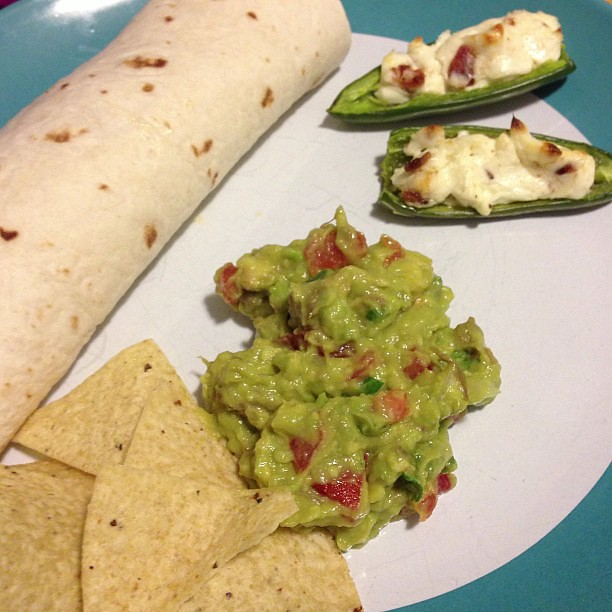 Dinner was Caribbean jerk wraps, stuffed jalapeños, and homemade guac.