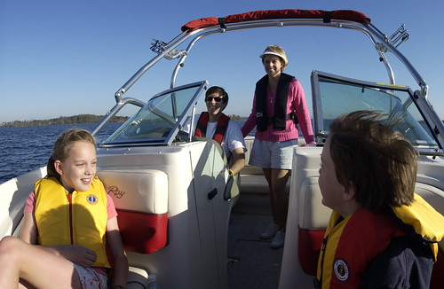 A family enjoying safe boating by wearing lifejackets