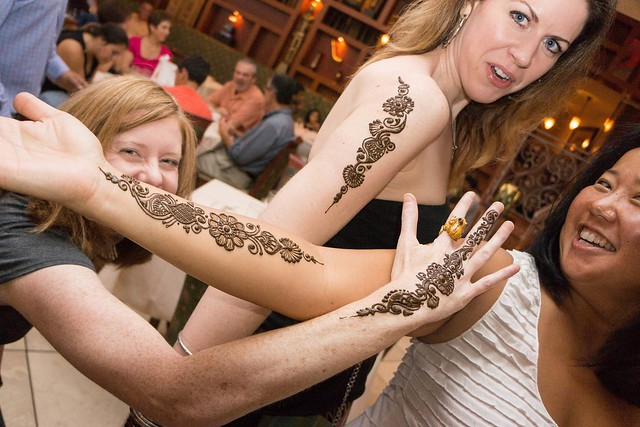 Girls showing off their tattoos provided by an on-site artist at Mehndi.