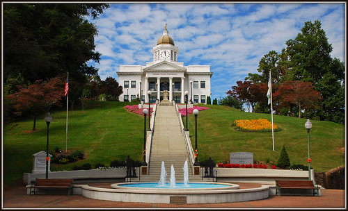 flowers tower clock water fountain lamp clouds stairs bench nc streetlamp flag steps northcarolina flags historic clocktower courthouse lamps sylva historiccourthouse timesgoneby jacksoncountycourthouse nikkor1685vr sylvacourthouse themostphotographedcourthouseinnc