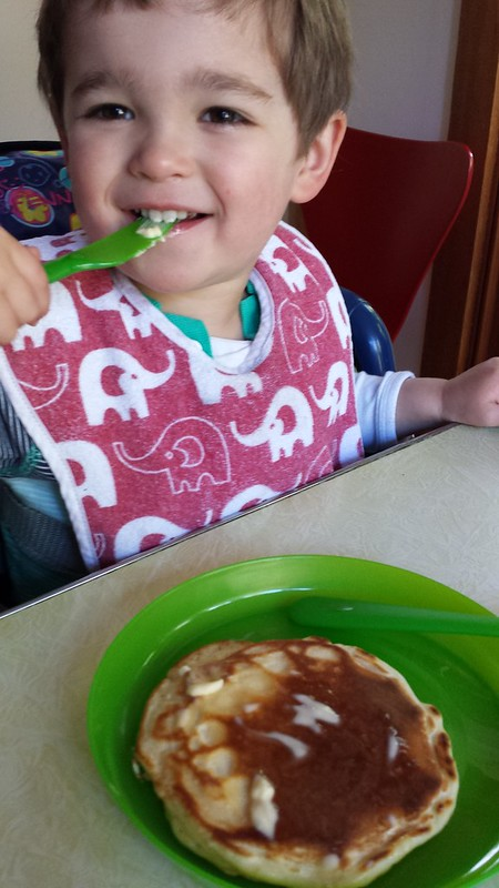 Hmmm. . .Eskil taking after his MorFar: served pancakes, but eating the butter