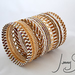 Pattern Play Bangle II in white and gold, 2014  Both jewelry and sculpture.
