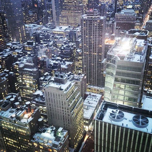 Snow never stopped New York City.. The lights burn bright illuminating the snow-topped buildings.  It's actually a pretty sight from my perch.  It tells me how cold it might possibly be but I'm all bundled up.  Keep warm!  #mynewyork #snowneverstoppedNYC