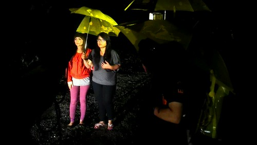 Lead actresses Wawa Zainal and Elliza Razak acting in the rain