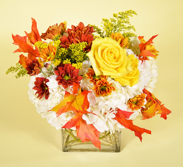 Short centerpiece with yellow roses red floral and fall - Red and yellow centerpieces ...