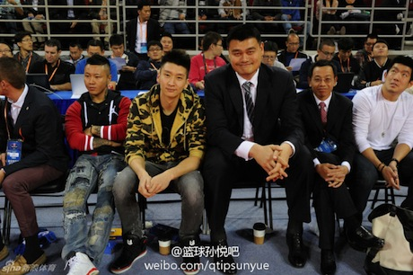 October 15, 2013 - Yao Ming watches an NBA preseason game in Beijing with friend Sun Yue